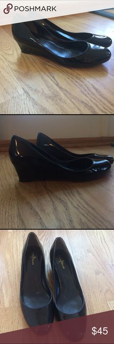"""Cole Haan wedge pumps Classic black patent 1-1/2"""" high pumps by Cole Haan with Nike Air technology for comfort and style that goes with everything! THIS IS A RE-POSH: size says 7-1/2 but I found them too tight and believe they fit more like a 7.  Sole measures a fraction over 9-1/4"""" inches long from edge of heel to tip of toe on the bottom of shoe, if you want to compare to a pair of yr own. Cole Haan Shoes Wedges"""