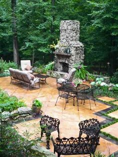 This cozy terrace is perfect for entertaining. Can you believe it was once a bare backyard with uneven terrain? The owners love the fireplace mantel, which was milled from a cypress tree grown on the property they own