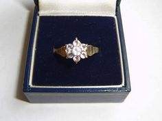 9 carat woman's gold engagement/anniversary ring of cluster clear stones size O.