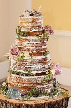 Naked wedding cake with large pink flowers