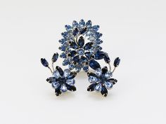 Blue Rhinestone Sherman Flower Brooch and Earrings - Vintage 1950s Demi Parure Signed Sherman by TheBirdcageVintage on Etsy https://www.etsy.com/ca/listing/295276653/blue-rhinestone-sherman-flower-brooch
