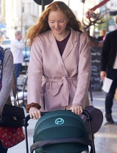 British model and actress Lily Cole was seen on the streets of London having a stroll with her adorable new girl Wylde in the CYBEX Cloud Q PRIAM Travel System.