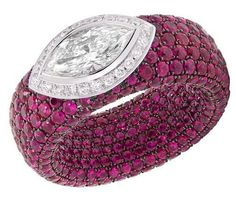 Avakian Cache ring with pave rubies and a marquise-cut diamond.