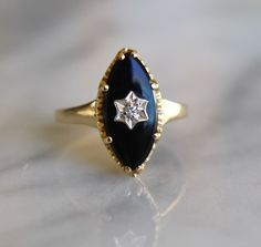 ANTIQUE ONYX 10K Art Deco era circa 1920s diamond accent gold vintage navette ring size 5.75 by ingramcecil on Etsy https://www.etsy.com/listing/220846884/antique-onyx-10k-art-deco-era-circa