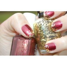 "Wrapped in Rubies"" by Essie Beautiful ruby red nails with gold glitter tips .."