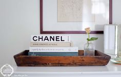 sweet vignette: rustic wood tray, a stack of books, and a single rose. Annie Leibovitz At Work, Cross Love, Interior Styling, Interior Design, Blog Live, Single Rose, Stack Of Books, Wood Tray, Storage Design