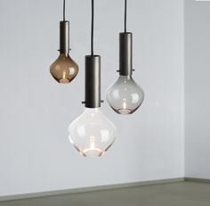 """Moni"" pendant made from handblown glass and browned brass cylinder with hidden light source/ isabel hamm licht"