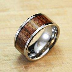 The Flat Polish Tungsten Carbide + Hawaiian Koa Wood Ring is a handmade accent piece that embodies the spirit of Hawaii. With a Koa wood inlay, it sticks out in any situation, whether you're keeping it casual or hitting the town.