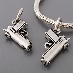 A fantastic pewter dangle charm in the shape of a gun This charm has a 5mm hole so is perfect for Pandora Biagi and Troll-like beading projects
