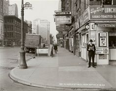 "In this May 18, 1940 photo provided by the New York City Municipal Archives, a man reads a newspaper on New York's 6th Ave. and 40th St, with the headline: ""Nazi Army Now 75 Miles From Paris."" Over 870,000 photos from an archive that exceeds 2.2 million images have been scanned and made available online, for the first time giving a global audience a view of this rich collection that documents life in New York City. #NYC"