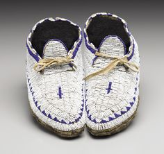 A PAIR OF SIOUX CHILD'S BEADED HIDE MOCCASINS. c. 1900. ... | Lot #77157 | Heritage Auctions