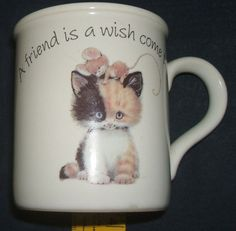 Carlton Cards A Friend Is A Wish Come True Stoneware Coffee Mug Tea Cup. Perfect for hot chocolate, coffee, tea, or other favorite hot beverage, this Carlton Cards cup will delight friends, cat lovers and Mug collectors alike.