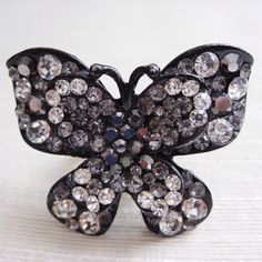 """Gunmetal Rhinestone Butterfly Ring Gunmetal rhinestone butterfly ring. Ring size is adjustable. Measures 1.5"""" x 2"""". Used in very good condition . Sold as is. I do not swap or trade!!! Message me if you have any questions. This item comes from a smoke-free and pet- free home. All sales are final. Thanks for looking! Please check out my other listings. Jewelry Rings"""
