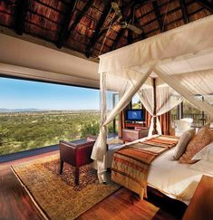 Watch zebras, antelopes, and wildebeests from your balcony at the Bilila Lodge Kempinski in Tanzania