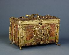 European gilded casket, c. 1400. Courtesy of the Victoria & Albert Museum.   This exquisite casket is adorned with lions and gilt metal fleurs-de-lys, and is characteristic of French Gothic decoration of the 14th century. The richness of the decoration and the themes chosen, suggest that it would originally have belonged to a prince or nobleman.