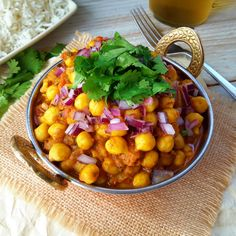 Easy and satisfying chickpea curry ready in 30 minutes. A simplified version of chana masala with regular supermarket spices. A great vegetarian or vegan main dish!