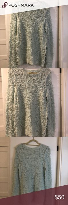 Free people blue fluffy sweater- never worn Size large- true to size for an oversized look. Awesome for winter and cold weather. Free People Sweaters Crew & Scoop Necks