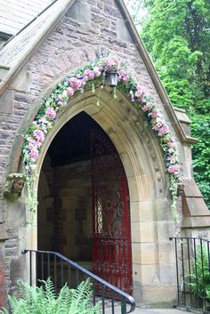 St Annes Parish Church, Singleton. The arch over the front door decorated for a wedding.  Hydrangeas, Orchids, Faith & Metalina Roses, Lisianthus, dill, Alchemilla Mollis and dangly Amaranthus.