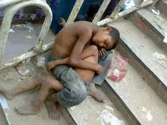 Orphan kid in India keeping his baby brother warm. God, my heart hurts. - Imgur