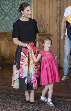Crown Princess Victoria looked elegant in a voluminous floral skirt from H&M She teamed the voluminous number with a simple black top and suede heels. Princess Estelle was pretty in pink dress by Bonpoint, teamed with silver shoes and white ankle socks.