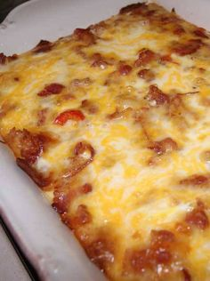 Recipe for Bacon Breakfast Bake - This DELICIOUS Breakfast Casserole is so good!! It uses tater tots instead of bread! It is comfort food at it's best!! Serve this casserole for any holiday breakfast or brunch!