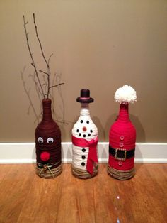 Christmas wine bottles - Snow mans hat as the neck of the bottle, the santa outfit as a santa hat