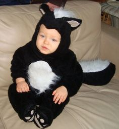 Little stinker. Austin Pratt Smelly the Skunk. Kitchen cabinet liners make great grippy foot pads and toes in this toddler costume. Credit: Tammy Pratt #costume #adorable