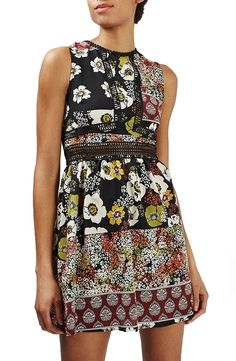 Adoring the zigzag crochet trim that outlines the bodice of this mixed floral-print sundress with a leggy, lightly flared skirt.