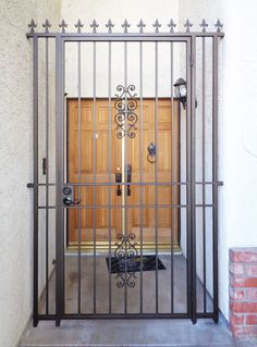 Wrought iron entry gate with fleur de lis finials Metal Gates, Wrought Iron Fences, Iron Gates, Burglar Bars, Fence Gate Design, Grand Entryway, Grill Door Design, Courtyard Entry, Entry Gates