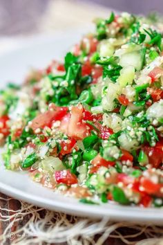 Tabouli Recipe | The Mediterranean Dish. Authentic Middle Eastern tabouli salad with fresh parsley, mint, bulgur, finely chopped vegetables and a simple citrus dressing. See the step-by-step tutorial at The Mediterranean Dish food blog.