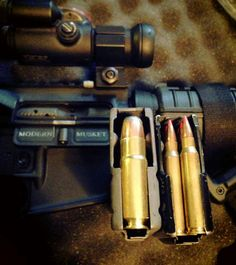 """.458 SOCOM with a 400 grain bullet on the left versus a .223 V-Max with a 50 grain projectile on the right.  Love the """"Modern Musket"""" on the dust cover of the AR."""