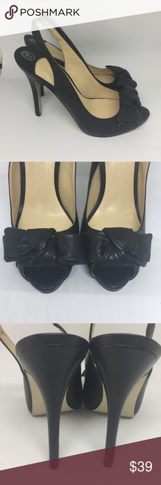 "Ivanka Trump Peep Toe Pumps IVANKA TRUMP FENNIA2 WOMENS BLACK OPEN TOE PUMPS LEATHER  BOW DETAIL SLINGBACK. There is some minor cracking on the inside and minor sole wear.  Measurements  Size: 8.5 M  Length of Shoe (sole top to bottom): 10.5""  Width of Shoe (sole widest point on sole): 3"" Ivanka Trump Shoes Heels"
