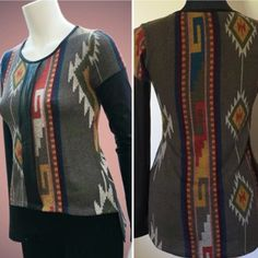 """SALE Hi-Lo Geo-Tribal Print Top NWOT Pair this fabulous tribal print top with your favorite skinny jeans. Solid long sleeves. Round neckline. It measures 20"""" long in front and 26 1/2"""" in back from shoulder to hem. Made in the USA. NWOT. Tops Blouses"""