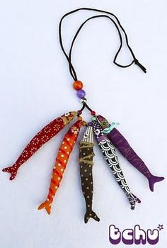 These fish are made out of fabric, they could easily be made out of Polymer clay