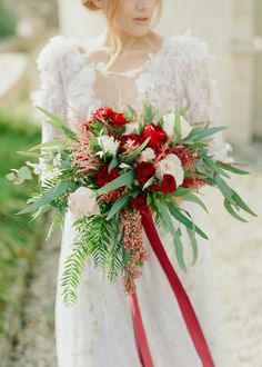 Bold red rose and greenery wedding bouquet: Floral Design:  Rizos Gardens  - http://www.rizosgardens.gr Photography: Adrian Wood Photography - adrianwoodphotography.com   Read More on SMP: http://www.stylemepretty.com/destination-weddings/2017/02/07/a-dream-dress-and-greece-make-for-the-most-beautiful-combo/