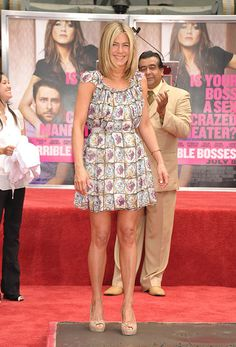 Jennifer Aniston in a cute Prada dress and Gucci shoes during her Hollywood Handprint Ceremony