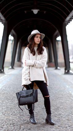 Nisi is wearing: Céline Belt Bag, Fedora Hat, Distressd Denim, Ripped Jeans, Chelsea Boots, Oversized Sweater