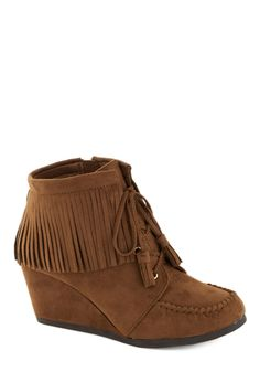 My newest bootie!  Friends with Fringe Bootie. These cinnamon-brown moccasin wedge booties are your soon-to-be style sidekicks! #tan #modcloth
