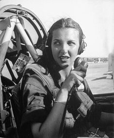 WASP pilot Nancy Nesbit seated in the cockpit of an AT-6 Texan at Love Field Dallas Texas United States 1944.