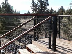 Deck railing ideas for the front of the house. Black Aluminum Posts with Wood Top Rail