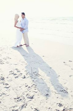 beach maternity photography - But write ella's name in the sand in front