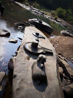"In Karnataka, India the river SHIVA""S DEVOTION Shikri water has reduced for the first time in the history and thousands of Shiva Lingas were seen under water. #Shiva #Shiva Linga in Water"