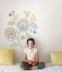 This fancy-chic flower wall decal kit creates a vibrant pop of color on walls With a fresh take on the Jacobean floral and dazzling gem accents the