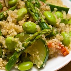Spring Green Quinoa + Edamame.     Love the salad made of quinoa, edamame and pea shoot with lime basil dressing