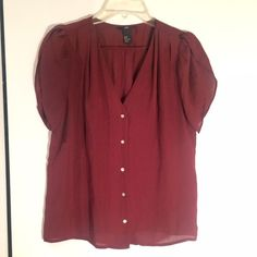 Wine blouse- perfect winter color! Wine blouse with button front detail. H&M size 8, like a size medium. H&M Tops Blouses