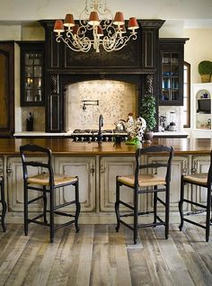 Love so much about this kitchen. Check out the great wide plank floors, elegant rustic cabinets, wood counter top, and the beautiful chandelier!