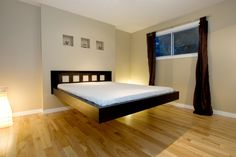 Wonderful-floating-bed-design-inspiration-with-awesome-black-wood ...