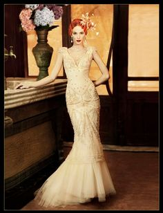Yolan Cris wedding dress. I'm in loveeeee with the beading on the chest and sleeves <3
