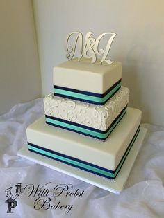 https://flic.kr/p/xGL86s | Three tier square wedding cake with royal and light blue ribbon