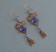 A personal favorite from my Etsy shop https://www.etsy.com/listing/514496830/blue-antique-copper-earrigns-blue